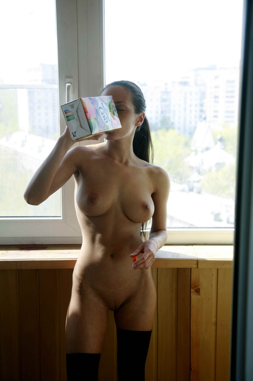 nude girl drinking